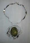 Leaves of Silver Statement Necklace Framing a Green Amber